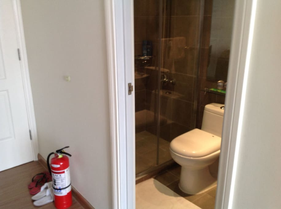 Shower room, in the unit with water heater. Foot mat or foot towel is provided. Fire extinguisher provided. Fire alarm inside the room.