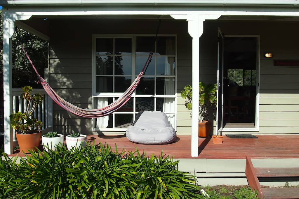 Enjoy the sun relaxing on the outdoor beanbag or hammock.