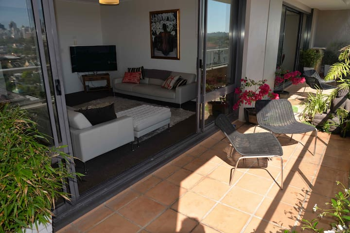 Balcony off the lounge, great for soaking up the sun, with the city in front