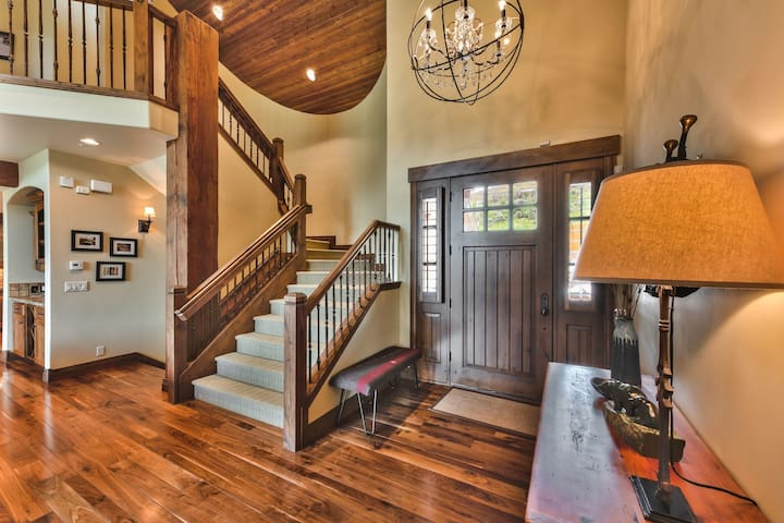 Front Entrance into Main Level Great Room with Living Room, Dining Area, Kitchen, and Wine Bar with Beautiful Hardwood Floors and Views!