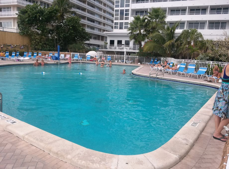 Large heated swimming pool for the resort guests only.  Next to tiki bar and beach