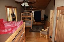 Bunk room with 2 sets of bunk beds, and flat screen TV. Great place for kids to go hang out.