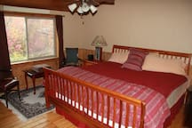 Upstairs master with King bed. Shared bathroom.