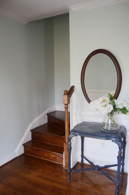 wood stair case and coat closet