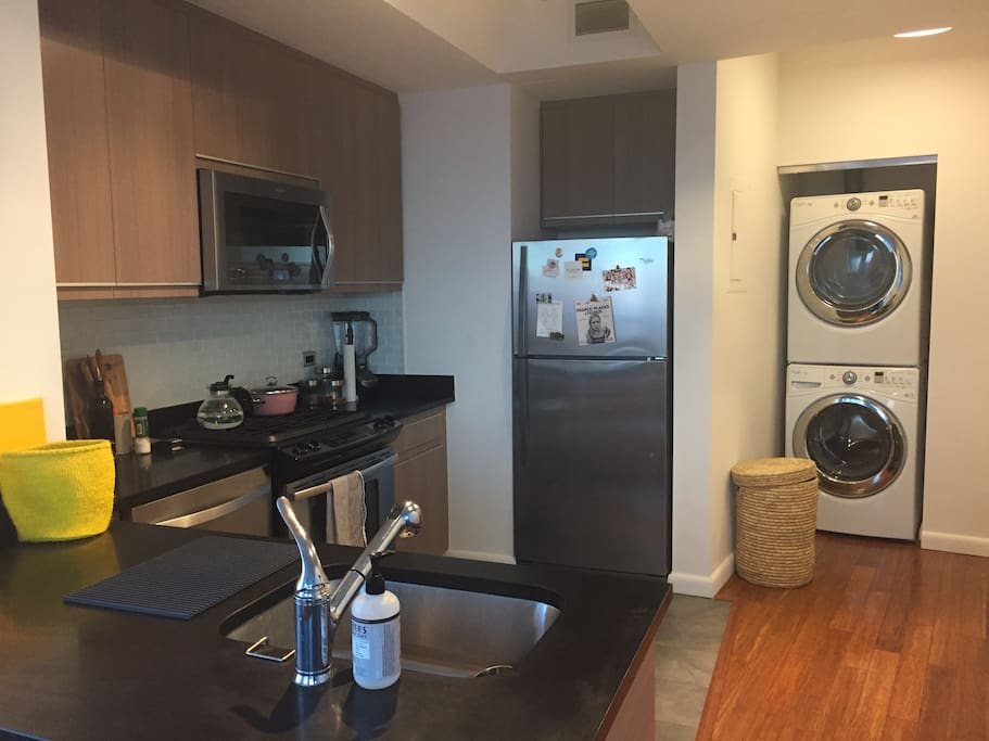 Kitchen area with new appliances, including a dishwasher