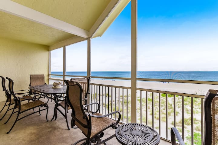 Waterfront condo with furnished balcony overlooking the pristine beach