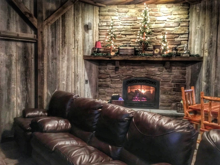 leather couches, fireplace and tables/chairs