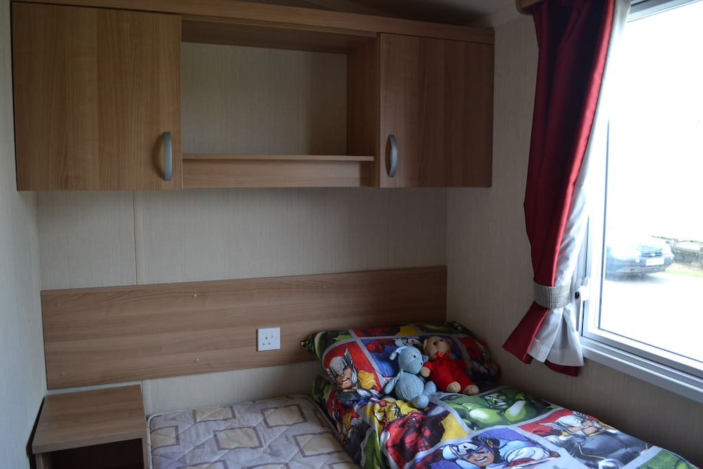 Second bedroom with 2 single beds, which can be pushed together. Cupboards, wardrobe and bedside table.