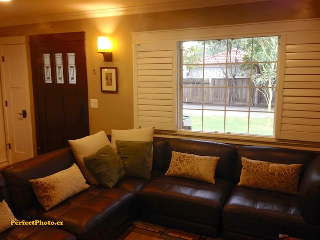 TV room with large sectional sofa