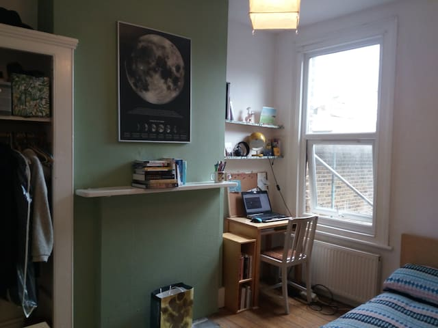 Warm and lightly room in a  friendly house