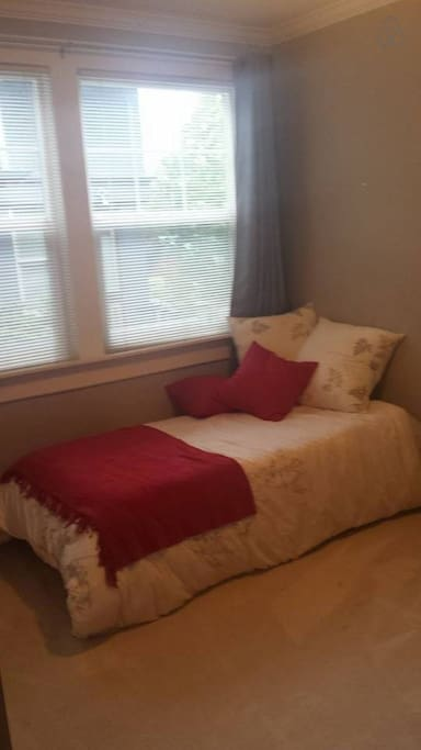 Comfy single bed in spare room/office.
