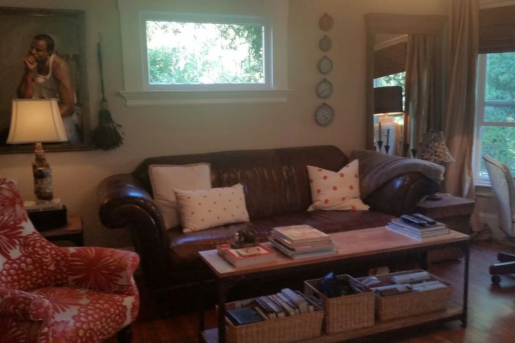 Living Room with Flat Screen TV and writing desk.