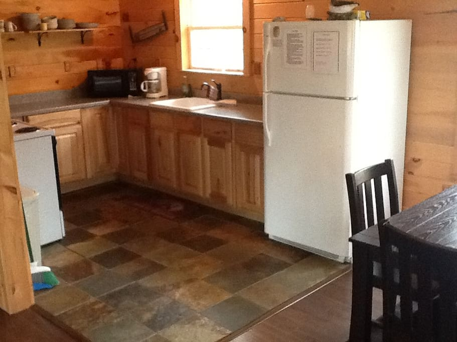 Fully stocked kitchen with beautiful slate tile and full sized appliances!