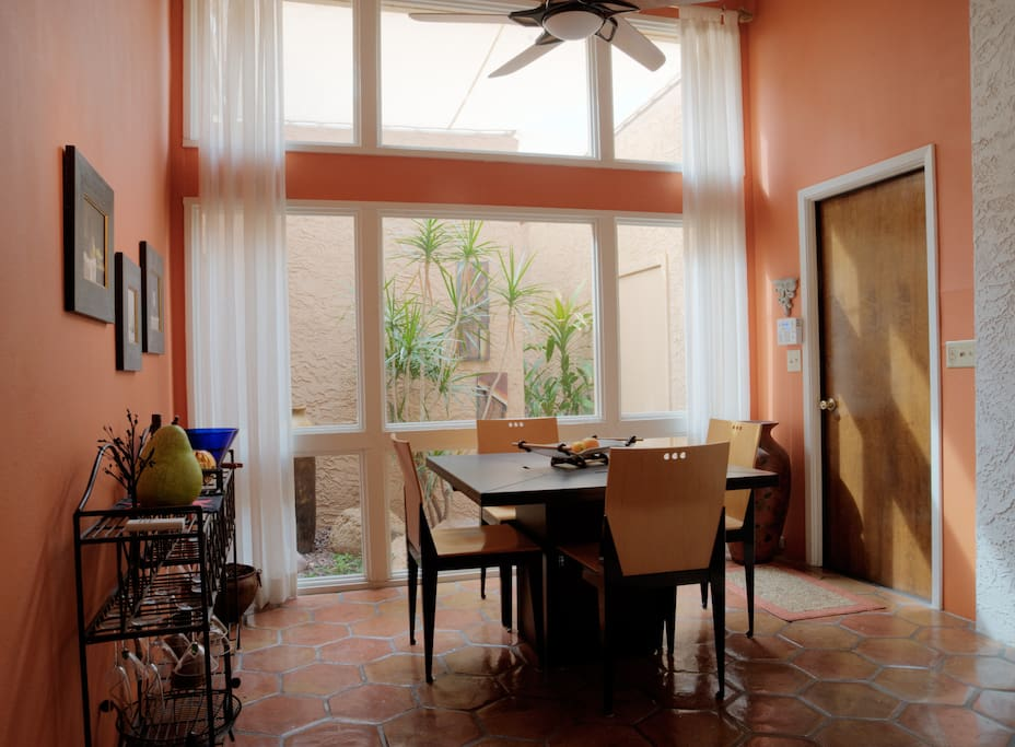 A bright sunny morning in the dining room. The door to your garage space is to the right