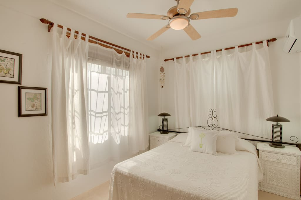 Master Bedroom with nightly A/C included in rate, and a ceiling fan.