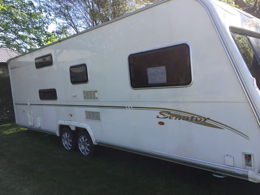 Larger roomy Caravan parked in a private setting