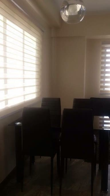 Sliding Window with blinds, dining table (pic was taken in the morning; doors closed)