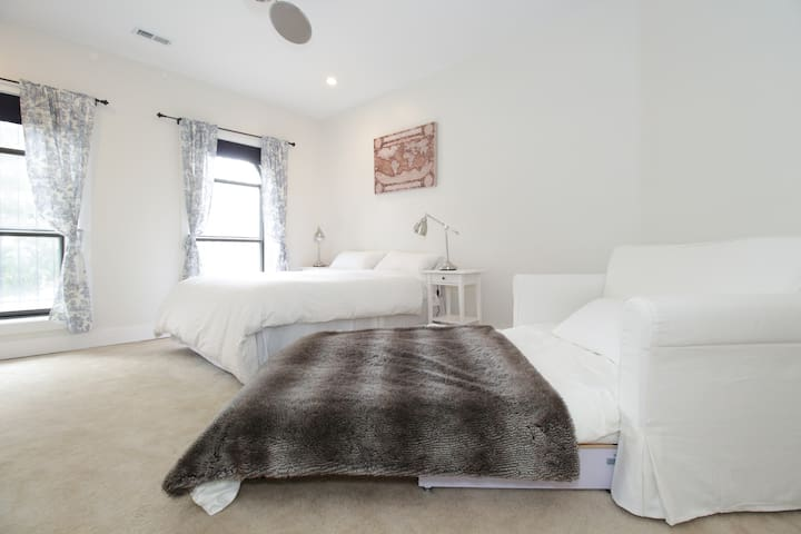 Queen bed with full size sofa bed.  Street view.