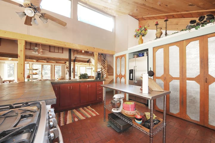 The open floor plan allows the chef to interact with the other guests.