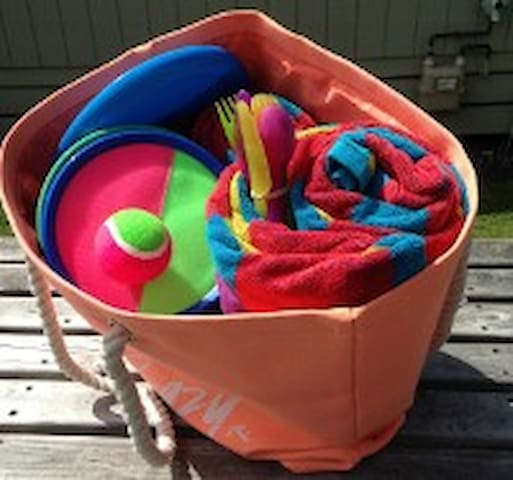 our brand new beach bag with big towels, picnic set and a frisbee