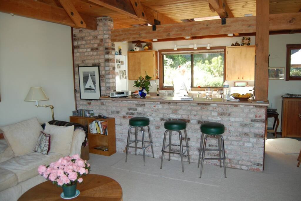 Mid-day shot of the living/dining area, the stools on the left are in front of a