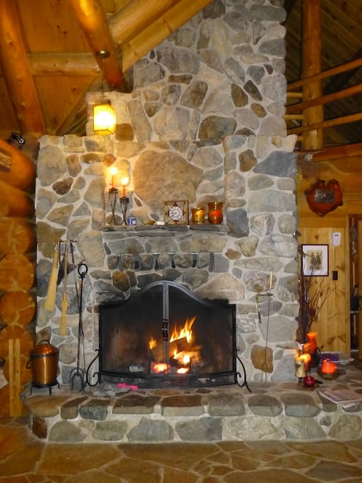 This is one of two, floor to ceiling fireplaces built from local river rock.