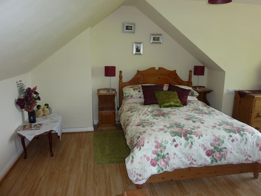 Large bedroom with panoramic river & rural views.