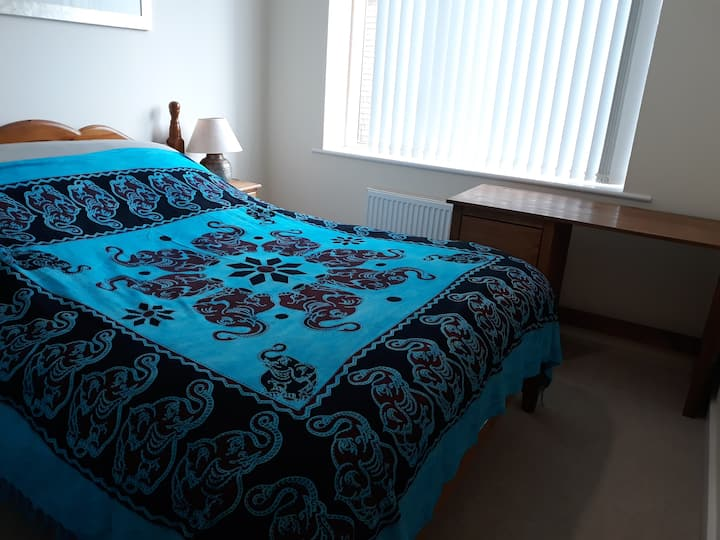 Peaceful ensuite room with comfy king size bed