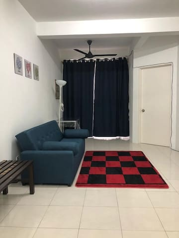 Spacious family area that has sofa bed, LED tv and multipurpose table.