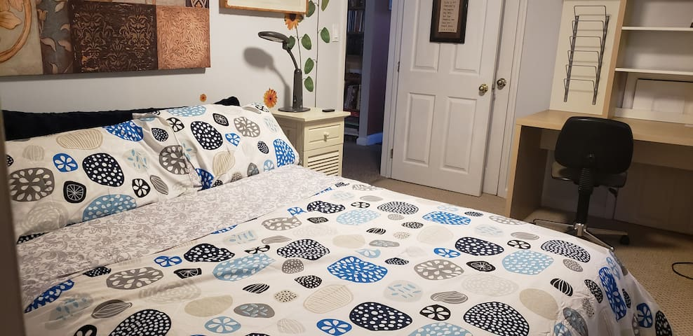 Queens Size Comfortable bed with desk and closet