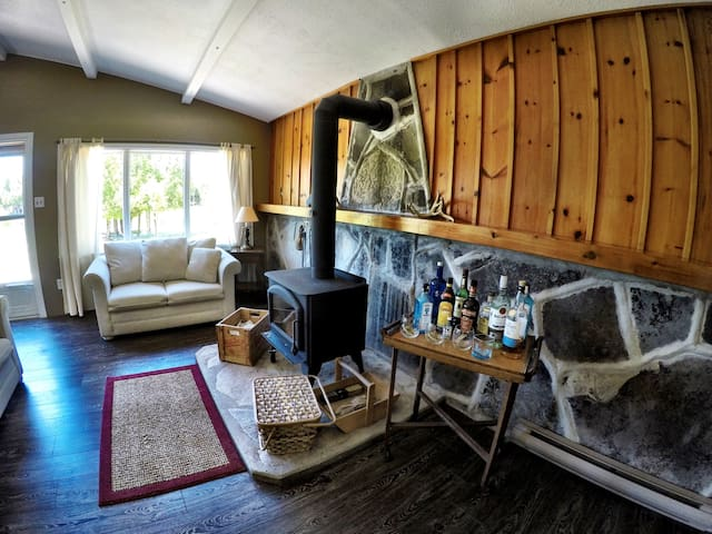 The main room of the cottage with wood burning stove