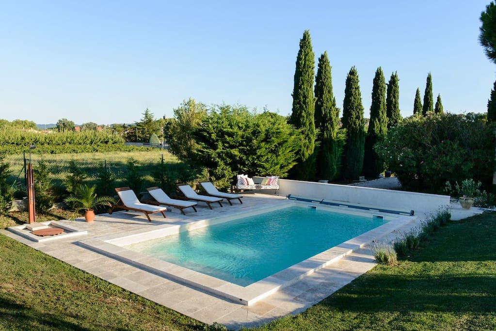 The private pool is in the back yard with views accross the vineyards.