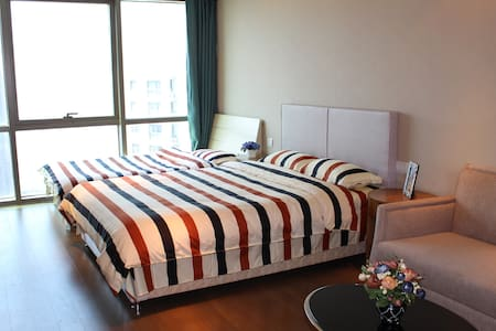 邮轮母港旁无敌海景家庭公寓-YOYO'S HOME - Qingdao