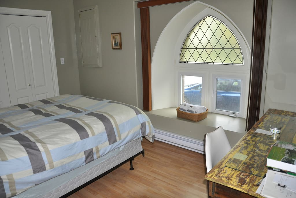 Guest room with gothic Church window. Photo by Airbnb Guest, Andrew of Caledon