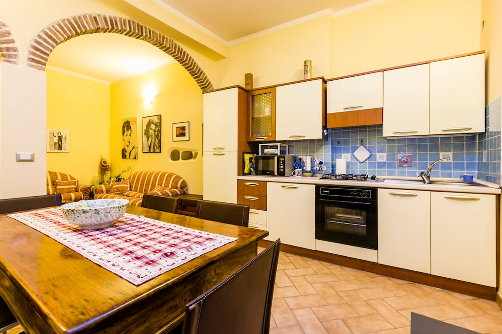 living room with full equipped kitchen