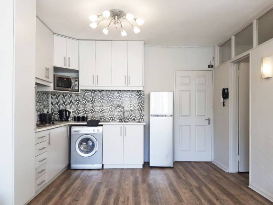 Open Plan Living space kitchen - includes: washing machine, fridge/freezer, microwave/convection oven, stove, and all the culinary bits you might need.