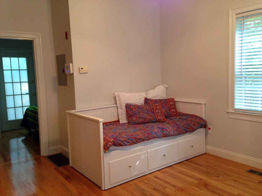 Pull out living room couch/day bed. Can sleep one person, or be pulled out for two.