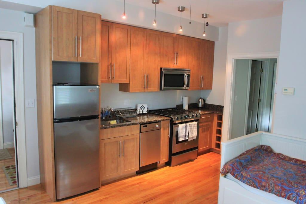 Beautiful, fully-stocked kitchen. Dishwasher, Gas Stove, Refrigerator.