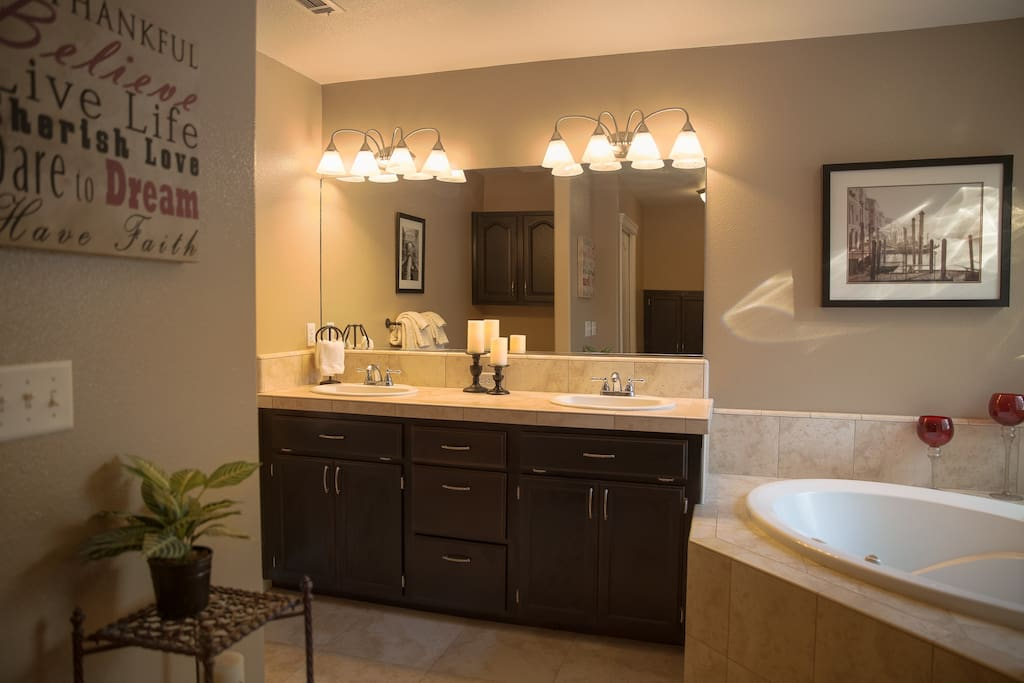 You will feel like royalty in this massive bathroom featuring a tile shower and jetted tub.