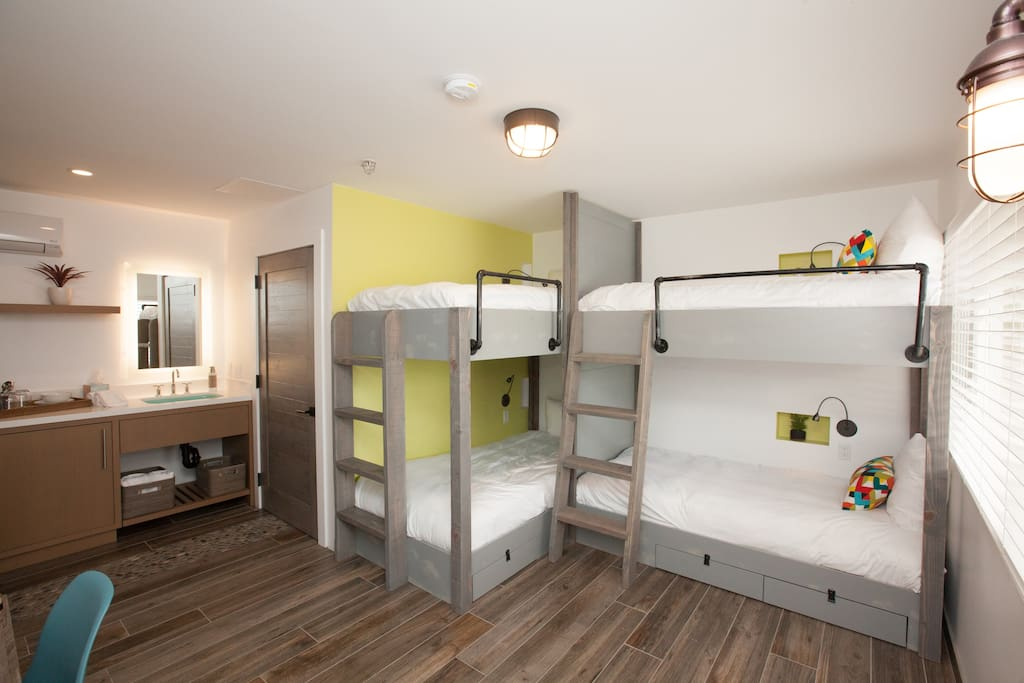 Custom built and ultra comfortable adult sized bunk beds.