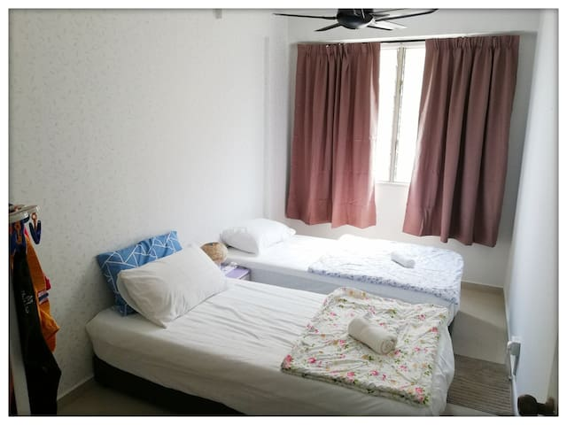 [Small room] Two single bed, ceiling fan, small table, clothes hanger. No air-cond.