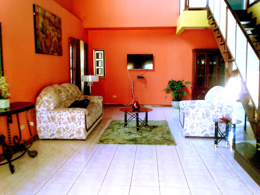 The spacious living room downstairs in warm colors.