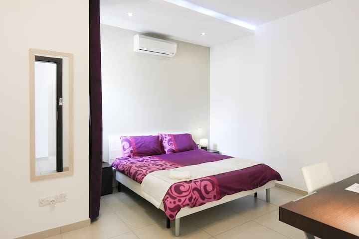 Bedroom with comfortable king sized bed