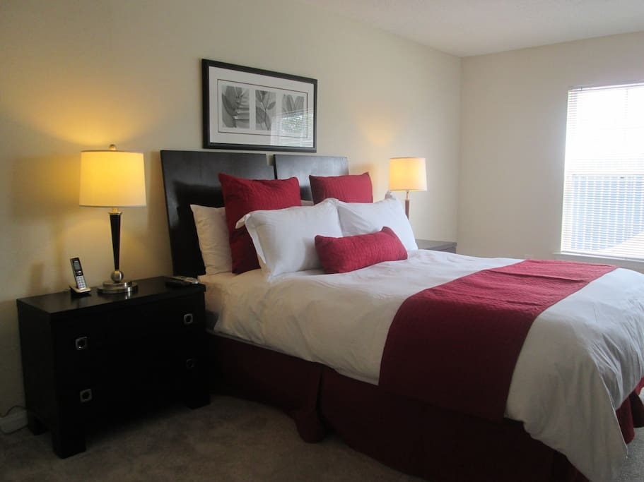 Spacious second bedroom with queen size bed and closet