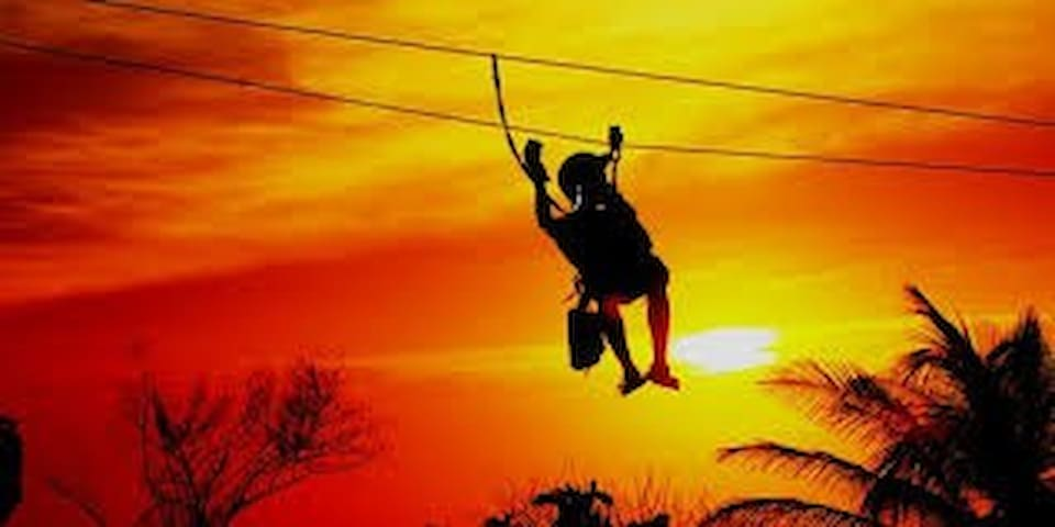 Zip line into the Sunset only a 5 minute Beach front walk away