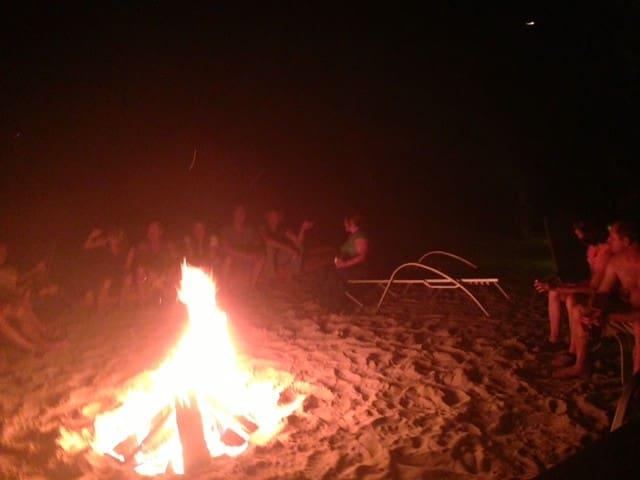 Turtle Beach guests enjoy a Bon fire on the Beach