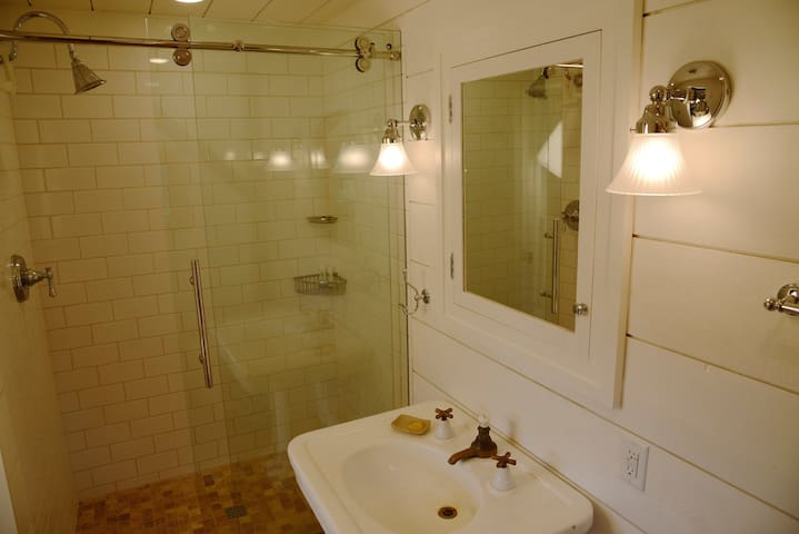 The bathroom is equipped with shower, fresh towels, and hairdryer.