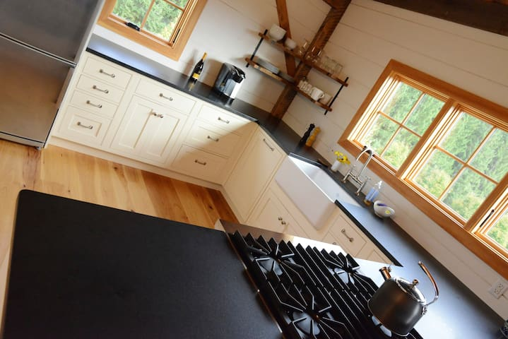 The kitchen features a four-burner Viking range, sharp knives, and most things any ambitious cook might need. A refrigerator, dishwasher, and microwave are also available.