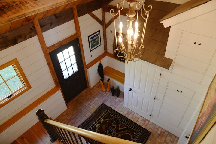 The Barn is accessible from the ground floor mud room via stairs. There is plenty of space for storing rods, clubs, and ski's, as well as extra layers and rain boots. Laundry facilities are located here.