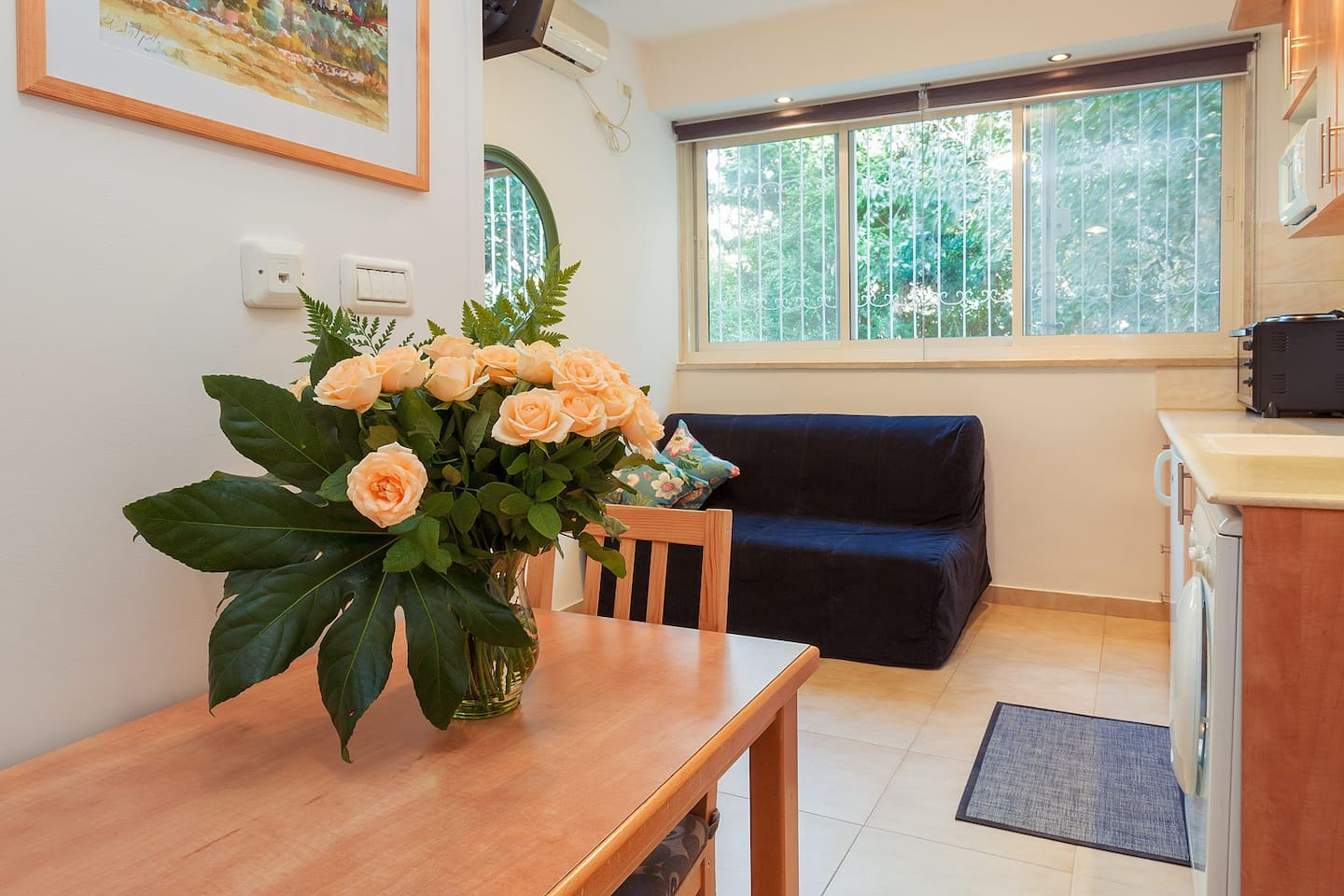 This one bedroom suite looks out onto fruit trees and blooming flowers.